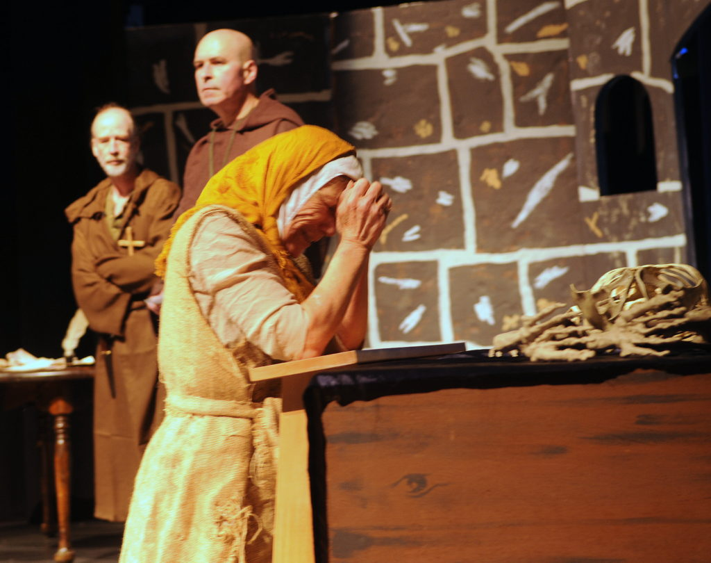 Judith McDermaid, front, plays a beggar woman in the Lynn Canal Community Players' rendition of Incorruptible: A Dark Comedy About the Dark Ages. The show opens this weekend in Haines. (Jillian Rogers)