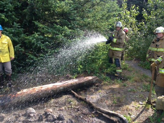 HVFD extinguishes the campfire. (Haines Borough Police)