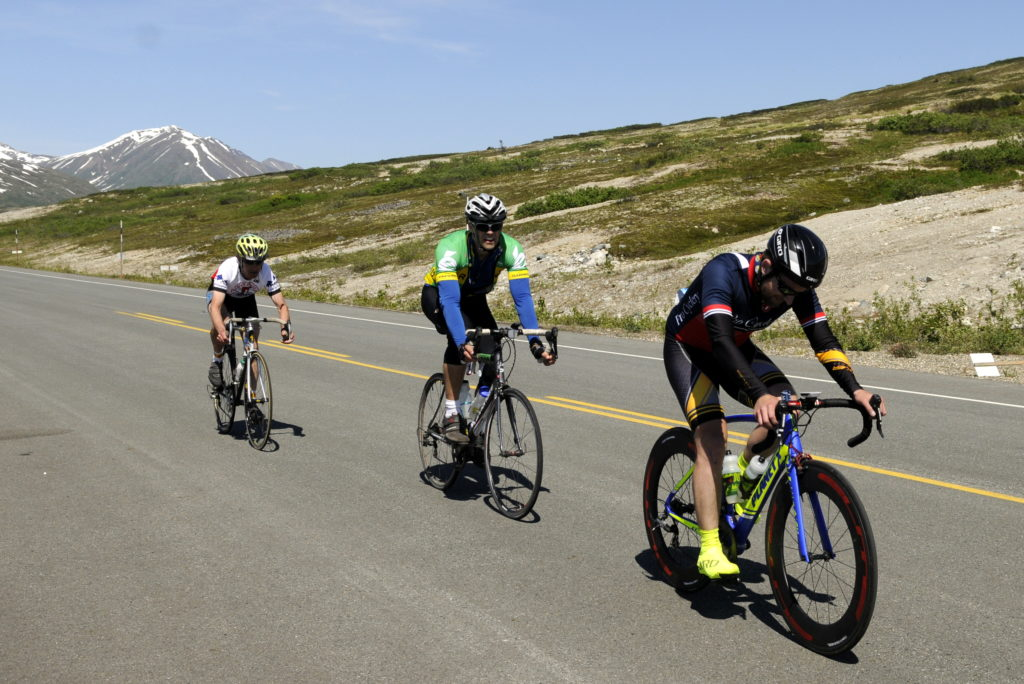 A pack of riders make their way past the summit checkpoint during Saturday's Kluane-Chilkat International Bike Relay. (Jillian Rogers)