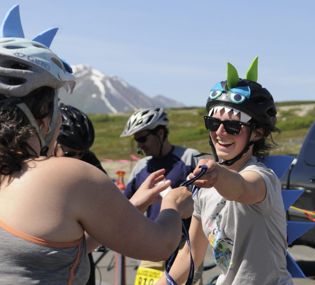 Riders tag off at the checkpoint during Saturday's Kluane-Chilkat International Bike Relay. (Jillian Rogers)