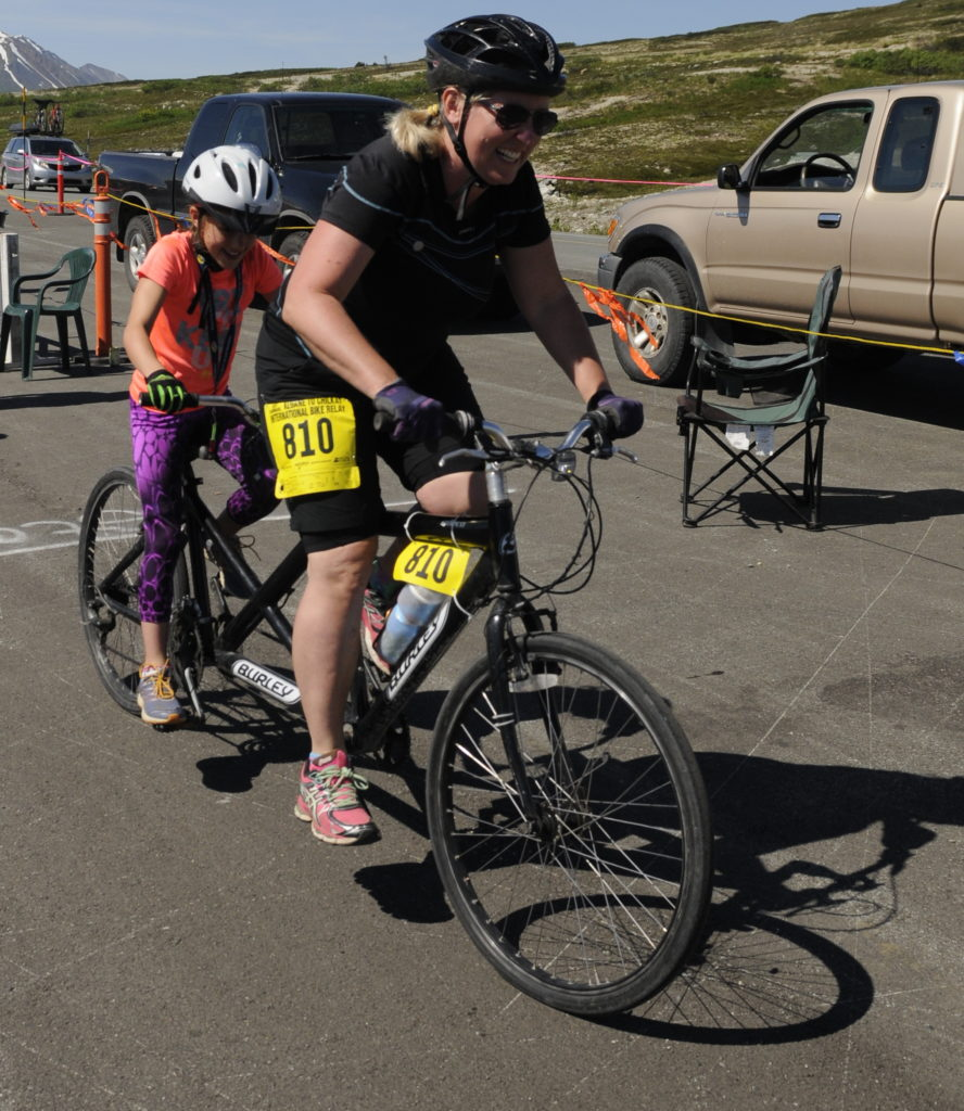 A tandem team takes off at the Haines Summit checkpoint during Saturday's Kluane-Chilkat International Bike Relay. (Jillian Rogers)