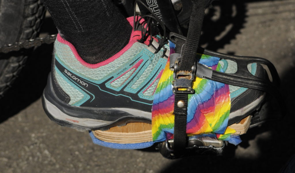 A young rider gets a lift taped to her shoes so she can reach the pedals during Saturday's Kluane-Chilkat International Bike Relay.