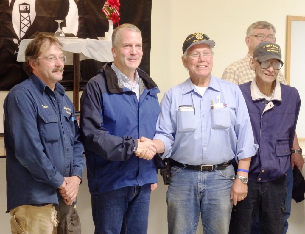 Sen. Dan Sullivan poses with Haines veterans after an hour-long conversation. (Emily Files)