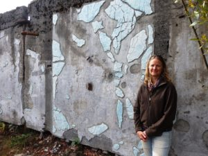 Kerry Cohen with her completed ceramic installation. (Emily Files)
