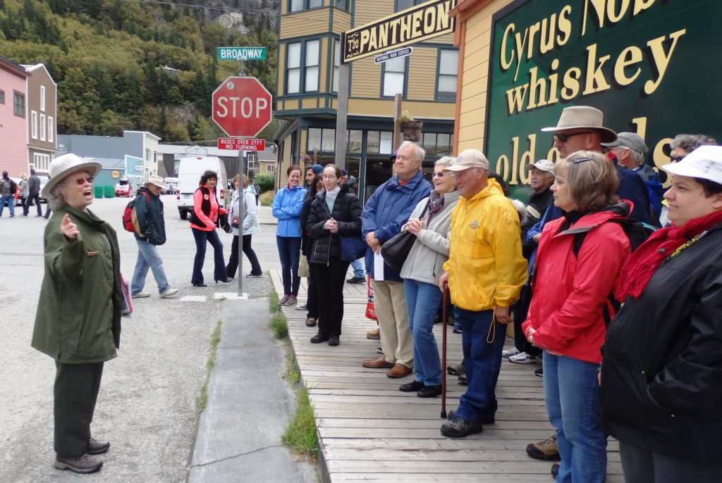 Park ranger Charlotte Henson leads a group of visitors on a walking tour of Skagway focused on the story of Company L. (Emily Files)