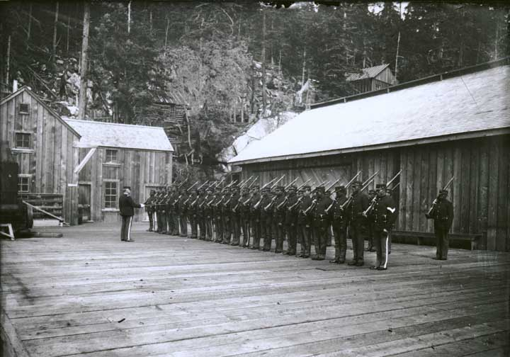 African American Soldiers stand at attention in Dyea, Alaska 1899. (Photo courtesy of Alaska State Library ASL-P226-867)