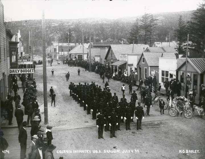 Company L of the 24th Infantry lined up in formation on Fifth Avenues on the Fourth of July in 1899 in Skaway, Alaska. (Photo courtesy of the Alaska State Library ASL-P75-144)