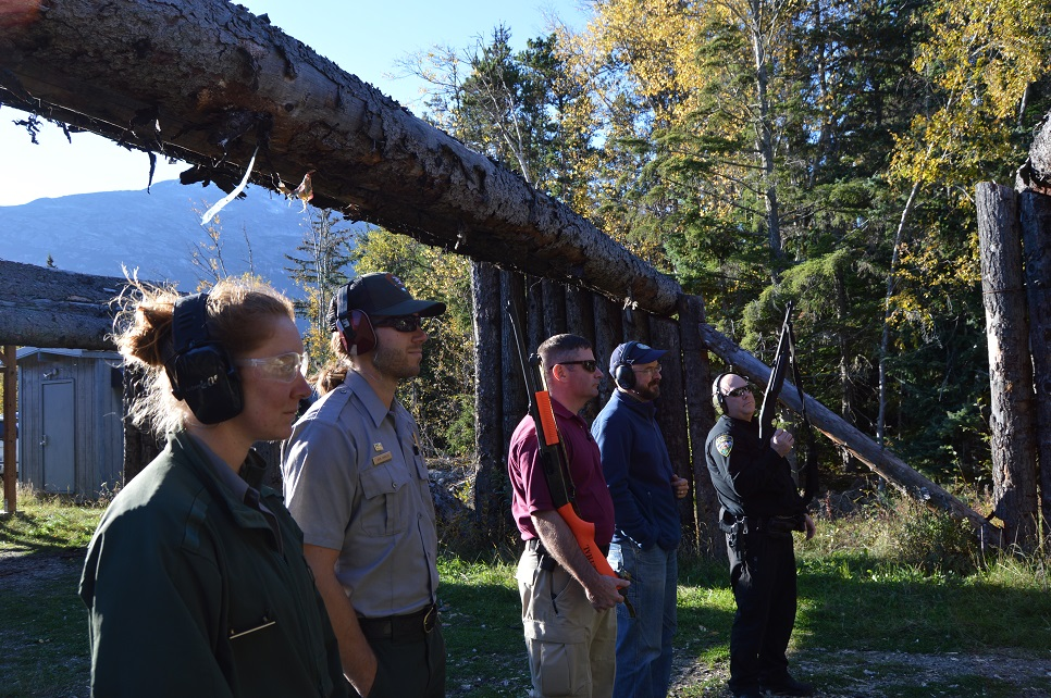Bear training participants including members of the National Park Service, Skagway Police Department, and Alaska Department of Fish and Game listen to instruction during firing range exercises.  (NPS Photo/K. Rain)