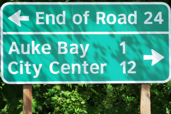 A sign near Juneau's Auke Bay Ferry Terminal points to the end of Glacier Highway. (Ed Schoenfeld/CoastAlaska News)