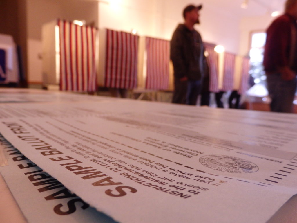 Voters cast ballots in Haines at the Chilkat Center. (Emily Files)