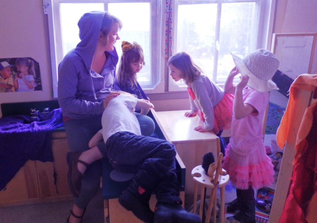 Teacher Vija Pelekis plays with Chilkat Valley Preschool students. (Emily Files)