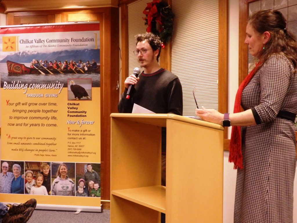 Erik Stevens accepts a $1,500 for the Haines Avalanche Information Center at a Chilkat Valley Community Foundation awards ceremony. Alekka Fullerton (right) was on the grant committee. (Emily Files)