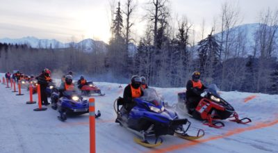 Snowmachiners line up for the 48th Alcan 200. (Emily Files)