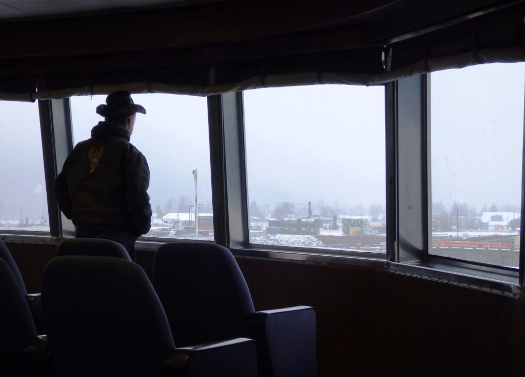 An Alaska Marine Highway passenger looks out onto Skagway's waterfront. (Emily Files)