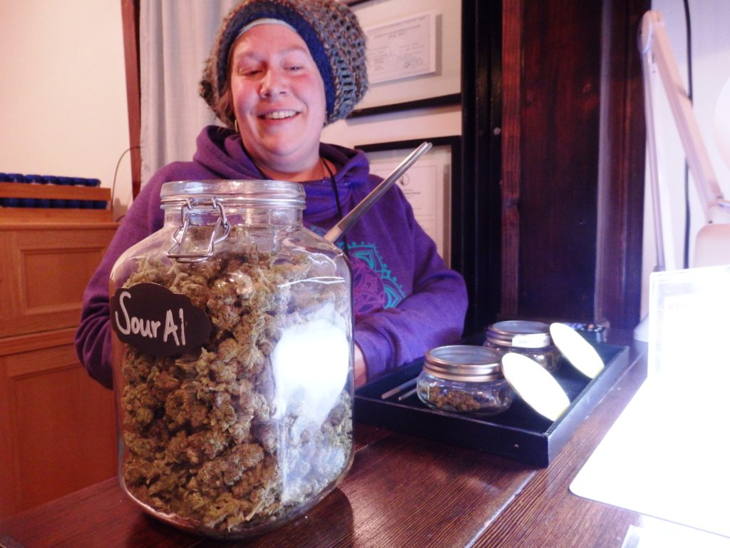 'Budtender' Reba Radey displays a strain of marijuana called 'Sitka Sour Al.' (Emily Files)