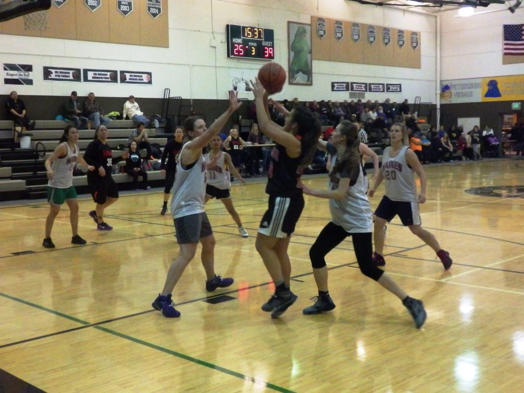 The Juneau Monstarz face off against one of the Haines women's teams. (Emily Files)