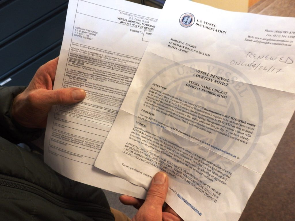 Haines fisherman Norm Hughes received two letters telling him to renew his Coast Guard documentation. The one on the left is from the Coast Guard. The one on the right is from a third-party company that charges three times as much. (Emily Files)