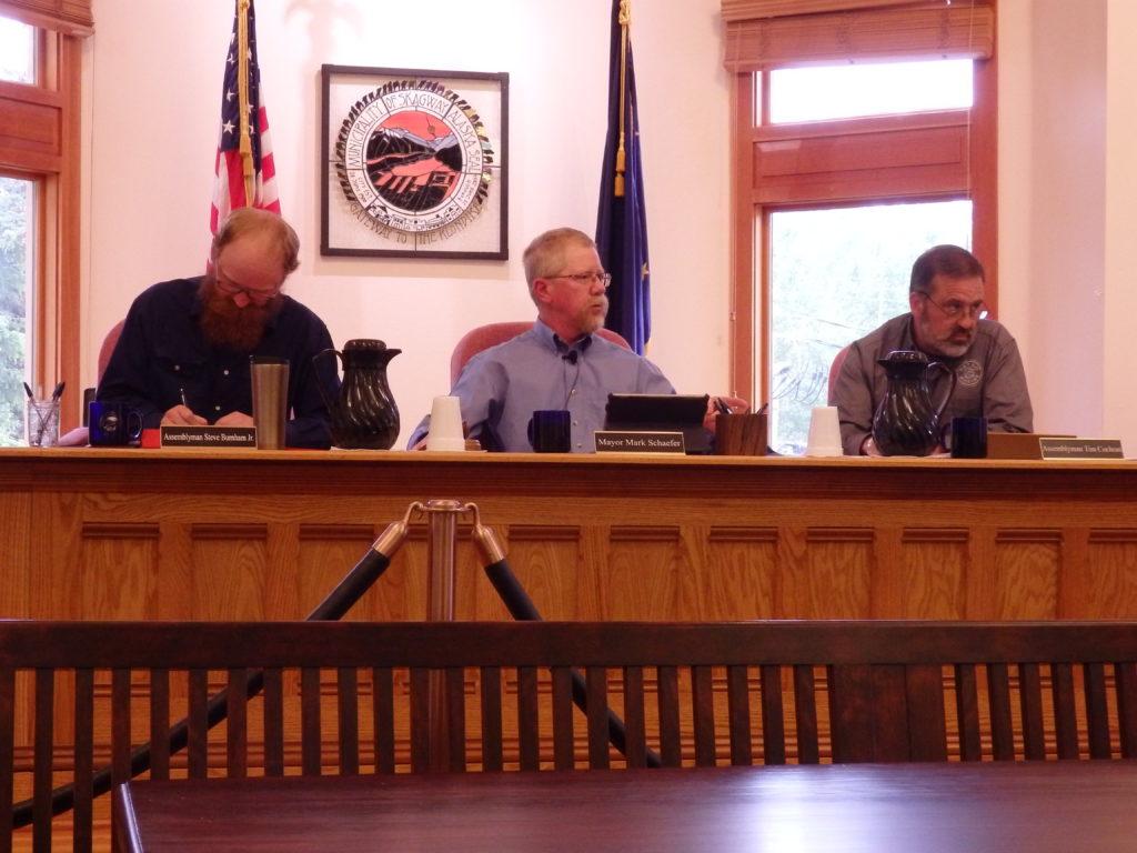 Assemblyman Steve Burnham Jr., Mayor Mark Schaefer and Assemblyman Tim Cochran at the June 15 assembly meeting. (Emily Files)