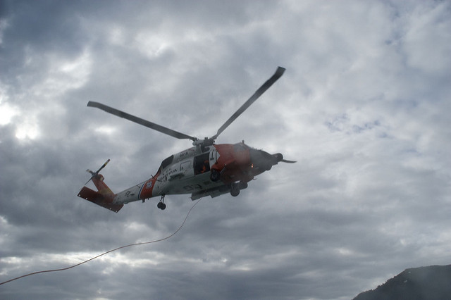A Coast Guard Jayhawk rescue helicopter from Air Station Sitka participated in a training exercise with a 47-foot motor life boat from Station Juneau five miles south of here in the Gastineau Channel near Taku Inlet Tuesday evening. (USCG Photo taken by Petty Officer 3rd Class Wes Shinn)