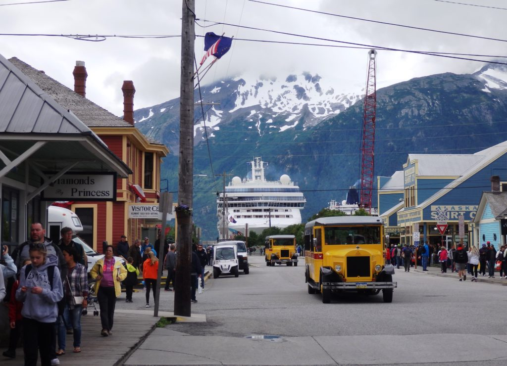INTRO: A meeting Thursday, Skagway Assembly members disagreed on many aspects of a proposed waterfront lease. The assembly does agree that a new contract with White Pass and Yukon Route Railroad should go to a public vote. But what that document will look like depends on whether the six assembly members can work through their differences. KHNS's Emily Files reports. _____ TRACK: The issue driving the lease discussion is Skagway's need to install a floating dock for larger cruise ships by 2019. White Pass manages the cruise ship docks. In order to make renovations, the railroad wants a 20-year tidelands lease extension. In an economic analysis, port consultants said that if bigger ships aren't able to dock in Skagway, the town will still see an increase in cruise revenue. It'll just be much less of an increase than it could get with the larger vessels. That prompted resident Ken Russo to question whether it would really be that bad for the city to lose those ships. ACT 2: Could you live with not as much of an increase for a year to give yourself some time to negotiate a real and effective and more fair win-situation for city? Rather than being pressured into we gotta do this lease right now, I'm under the gun, gotta do it, gotta do it. ACT 1: I do respect what is being said, that, is it the end of the world if we miss the boat one year? TRACK: That's Assemblyman Orion Hanson. He said maybe Skagway could sustain the loss in cruise revenue. But he worried about the negative affect that would have on local families. He related it to his childhood, when his father couldn't find work in Skagway. ACT 2: And so he went to Hoonah. And for a couple years, he built houses in Hoonah. And I was 5,6 years old when that was happening. And it wasn't very fun. I really don't want to see us lose business to Hoonah again. And I think we do have a crystal ball, we can see that's coming. TRACK: Hanson said he wasn't 'head-over-heels' for the lease proposal. But he said it could be a pal