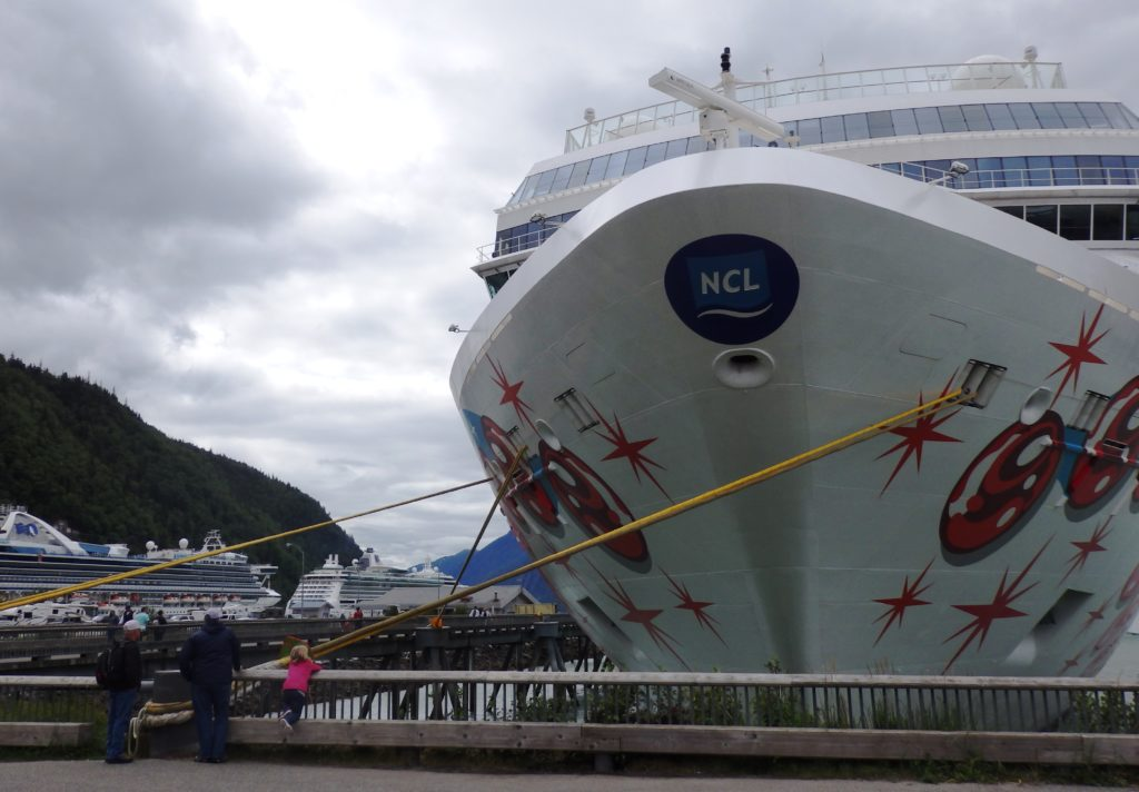The Norwegian Pearl tied up at Skagway's Broadway dock in July 2017. Two more cruise ships are moored at the railroad dock in the background. (Emily Files)