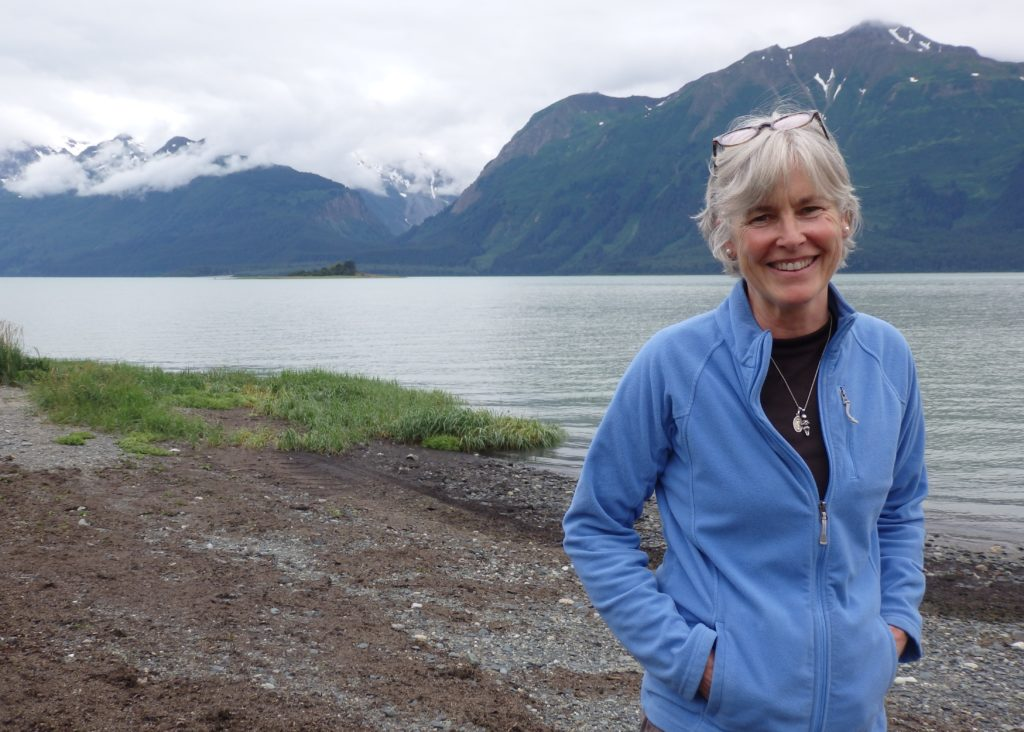Heather Lende standing on the beach outside her home in Haines. (Emily Files)