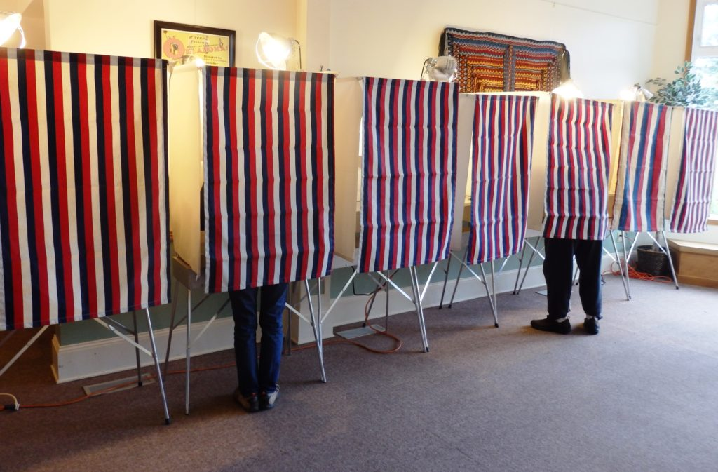 Haines voters may decide on two ballot questions in the October election.  The borough assembly moved the two ordinances forward at a meeting Tuesday. But neither decision was unanimous.  The first is in response to Haines' loss of trooper service. Alaska State Troopers moved its Haines post earlier this year. That leaves areas outside of the townsite without consistent law enforcement protection.  The ballot question would create a new service area, expanding the jurisdiction of the Haines Police.  Assemblyman Tom Morphet raised two concerns. One, he thinks the proposal should come from the public, not the government. Two, the question might signal that Haines is giving up the fight to reinstate the trooper post.  But Heather Lende said the borough would be remiss if it didn't have a back-up plan.  12BallotQs: Sure, ideally, we just want the trooper back. But if that isn't going to happen, we are at least giving residents an opportunity to vote on a different option. And one that by code, by service area, they will pay for the service.  The assembly voted 4-2 to move the police service area question to its first public hearing. Morphet and Sean Maidy were opposed.  The other possible ballot question is on a less-prominent topic. Right now, Haines' charter says certain borough officers serve at the pleasure of the assembly. They include the manager, clerk, chief fiscal officer and attorney.  That's led to questions about how the assembly should supervise and evaluate those staff when it only has direct oversight of the manager.  The ballot question would amend borough charter to say only the manager serves at the pleasure of the assembly. Morphet also objected to this idea.  12BallotQs2: I feel the clerk and CFO have considerable discretion and authority and in a real sense, have power in this chamber and over the people of the Haines Borough. And as such, I believe these  positions should answer directly to the public. And [the assembly] is the public. We represent the public.  But Morphet was in the minority. He and Tresham Gregg were the only 'no' votes.  Both the police service area and charter amendment ordinances will have public hearings July 25.
