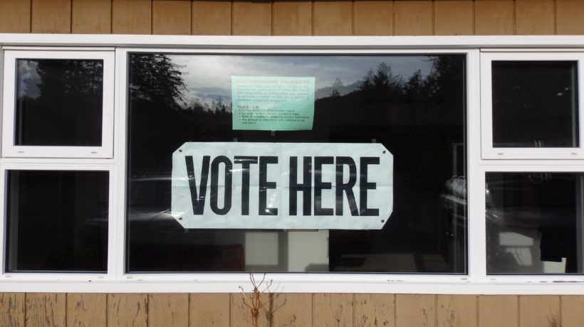 A sign hangs in the window of the Chilkat Center during the 2016 Haines municipal election. (Emily Files)
