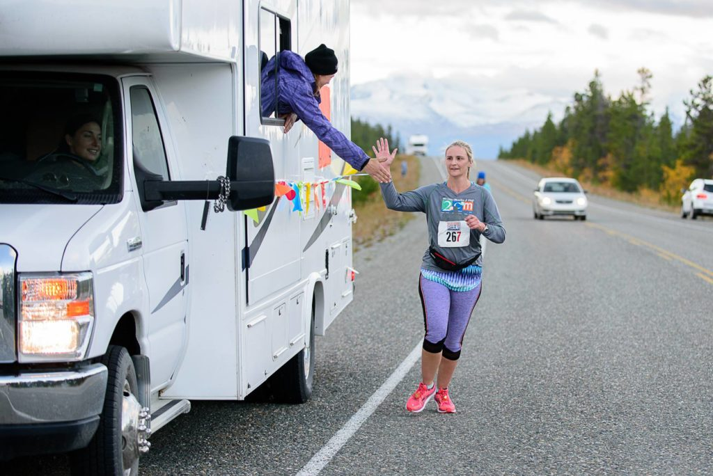 A runner gets encouragement from a supporting vehicle in the Klondike International Road Relay. (Courtesy Sport Yukon)