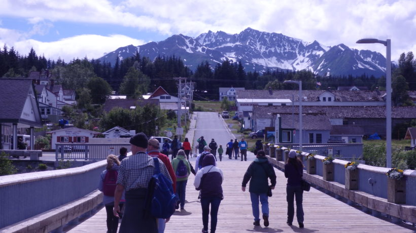 Tourists walk on the cruise ship dock towards Haines' Fort Seward. (Emily Files)