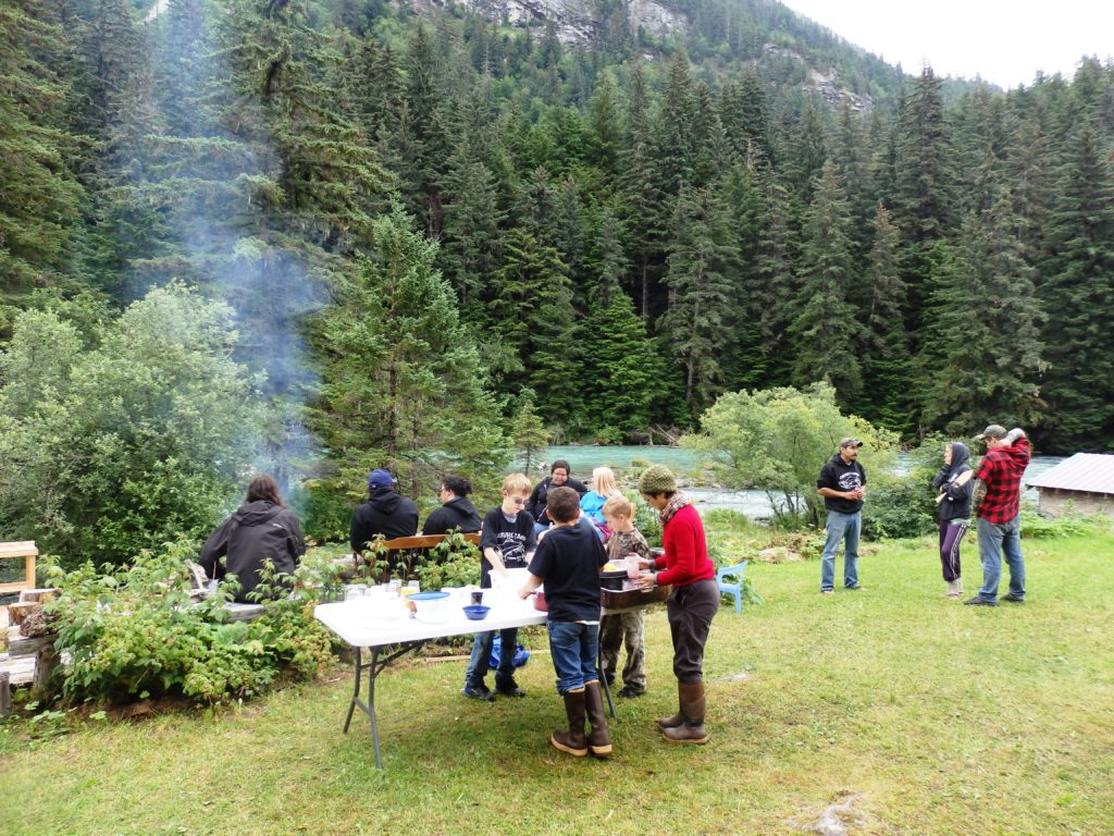Culture camp participants, friends, and family share a potluck on the last day of the July camp. (Emily Files)