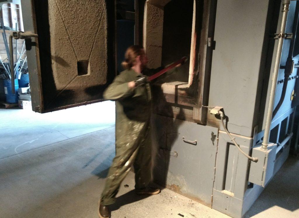 National Park Service maintenance worker Dan Grivois loads the park's waste incinerator on Sept. 5. (Jacob Resneck)