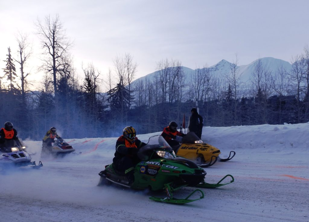 Snowmachiners compete in the Alcan 200. A new tour application would take visitors on snowmachine trips in the Chilkat Valley. (Emily Files)