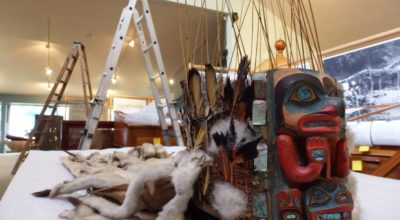 This headdress was carved by the artist Kadjisdu.áxch, who is known for carving the intricate Whale House Collection. It is on display in this exhibit as an example of the art that is part of the Tlingit culture. (Emily Files)