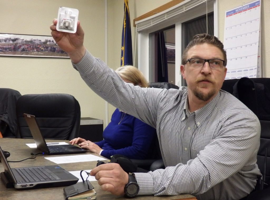 Haines Police Chief Heath Scott holds up the Narcan nasal spray he carries with him. Narcan is used to counteract opioid overdoses. (Emily Files)