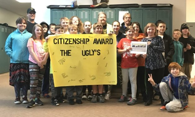 "Haines School students present a ""citizenship award"" to the Uglys"